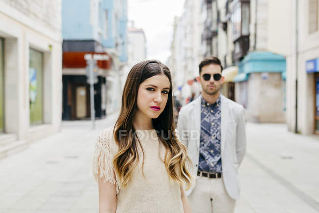 Stylish couple standing on street — Stock Photo