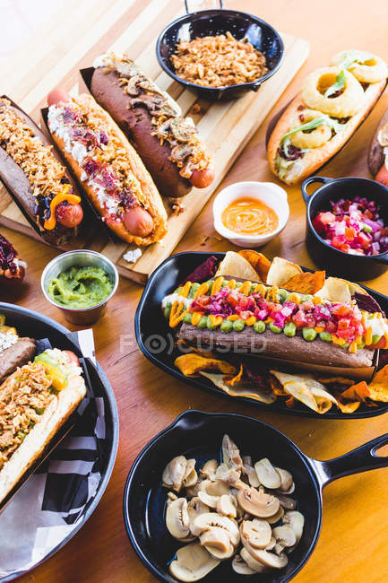 Served hot dogs and snacks — Stock Photo