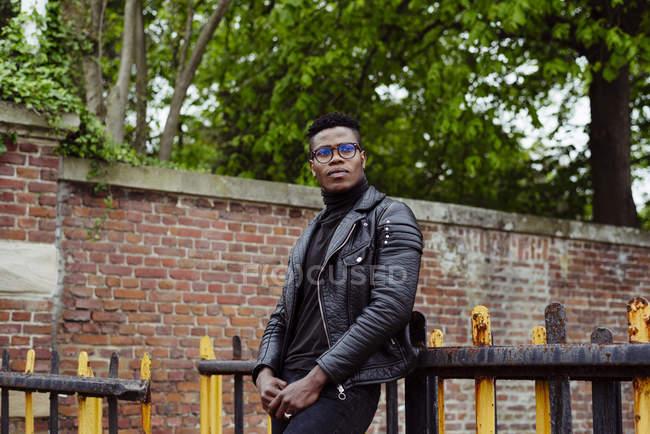 Black man standing at street — Stock Photo