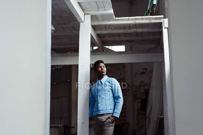 Black man leaning on wall — Stock Photo