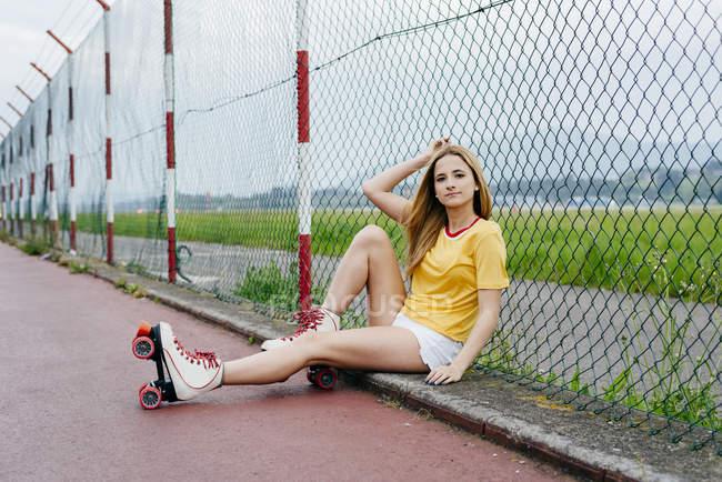 Teenage girl wearing roller skates — Stock Photo