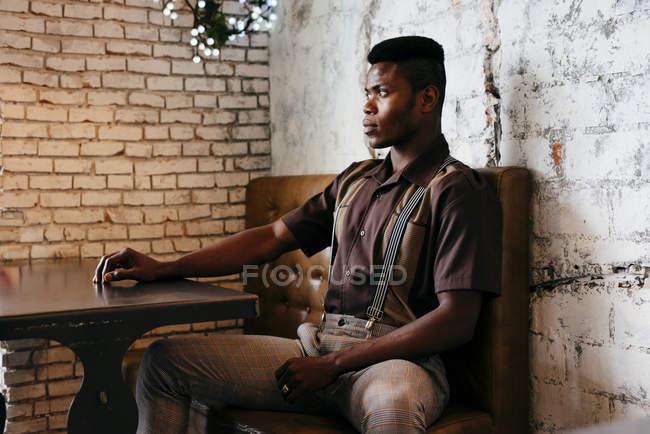 Black man sitting in cafe — Stock Photo