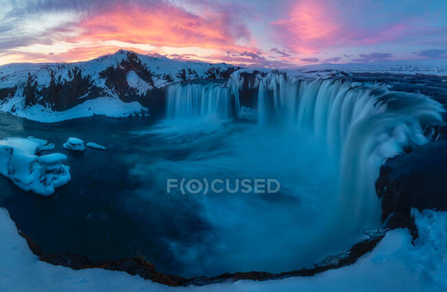 Majestic view of small waterfalls during amazing sunrise in Iceland. — Stock Photo