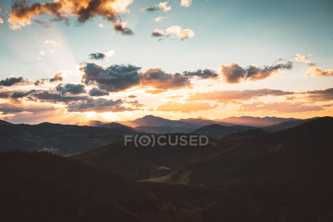 Colorful sky above mountain valley — Stock Photo