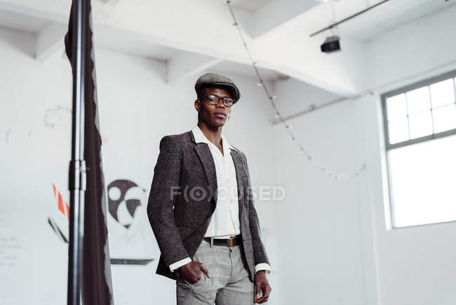 Stylish black man posing in studio — Stock Photo