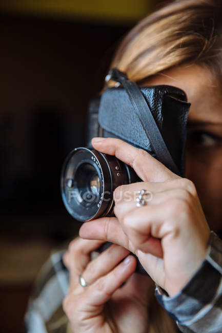 Woman taking photo with photo camera — Stock Photo