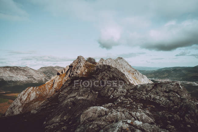 Rocky peak on mountain range — Stock Photo