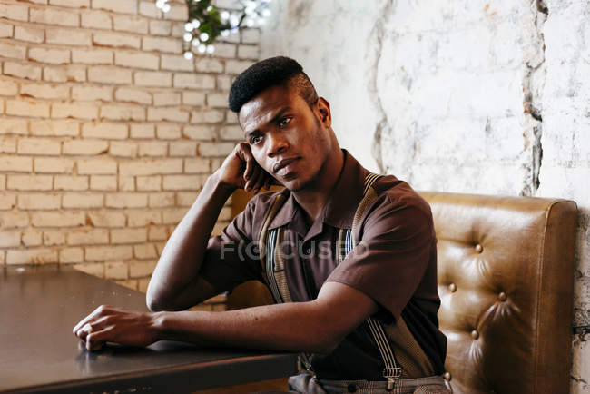 Black man sitting in cafe — Stock Photo