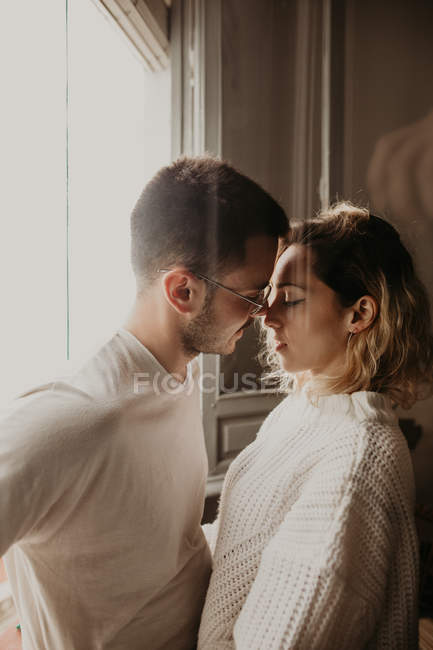 Affectionate couple embracing and bonding at home — Stock Photo