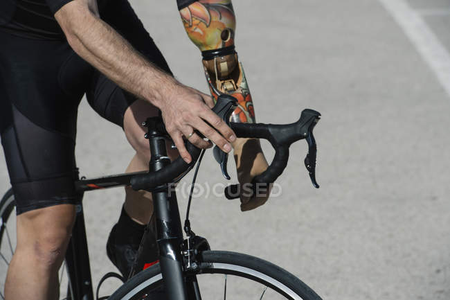Close-up of Handicapped man riding bike — Stock Photo