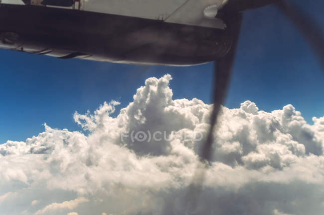 Clouds and blue sky from airscrew airplane — Stock Photo