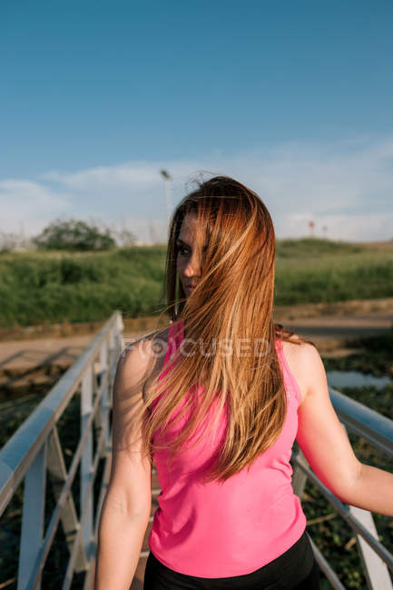 Portrait of attractive sporty young woman on pier — Stock Photo