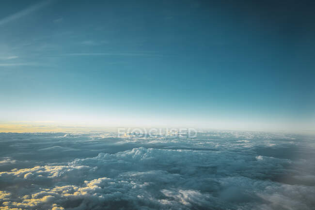 View of white clouds in blue sky from above — Stock Photo