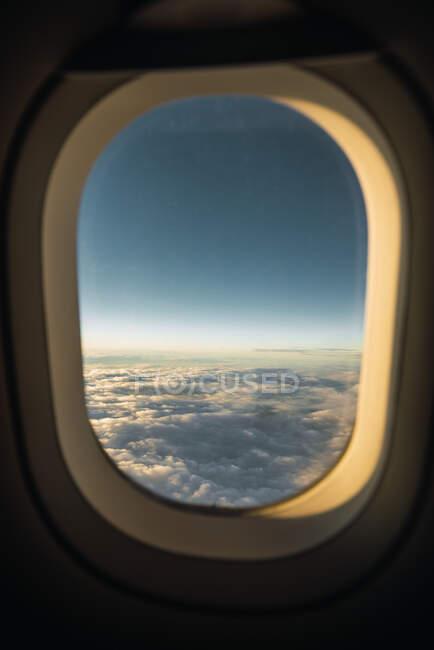 Airplane window in sunlight — Stock Photo