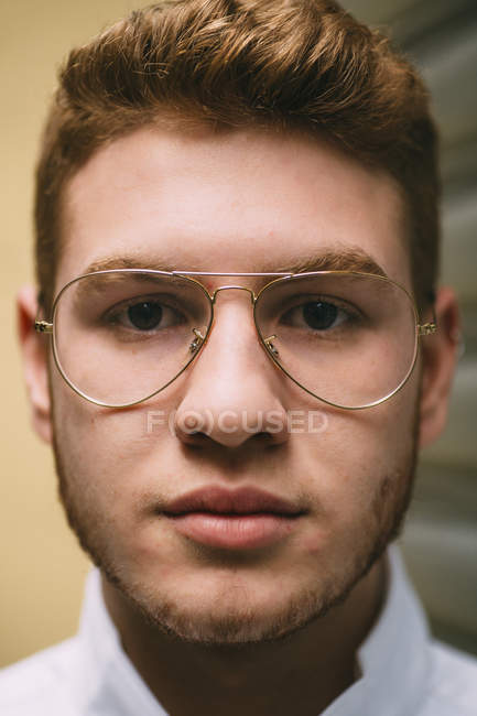 Portrait of redheaded man in stylish glasses looking at camera — Stock Photo