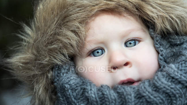 Portrait of cute little boy in warm jacket looking at camera — Stock Photo