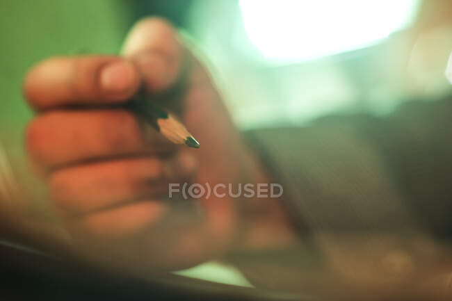 Close-up hand of unrecognizable person drawing with pencil — Stock Photo