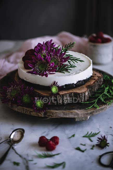 Yummy Cake Decorated With Fresh Flowers On Wooden Platter Still