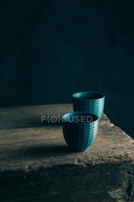 Cups of tea on dark wood — Stock Photo