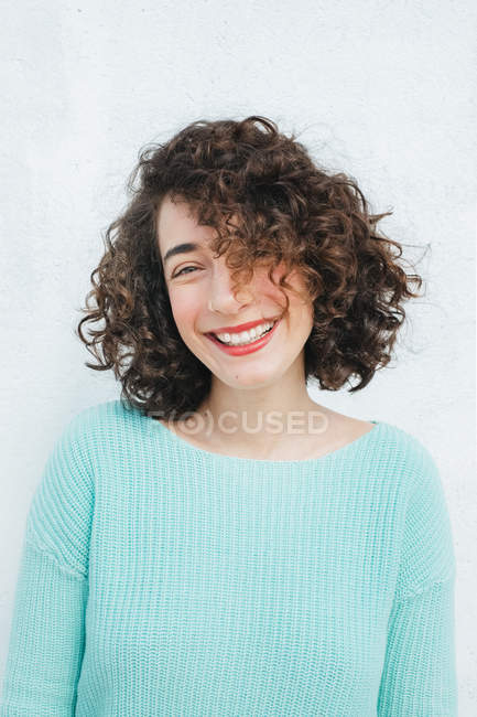 Smiling woman with curly hair — Stock Photo