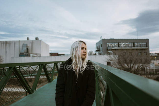 Woman walking on pedestrian bridge — Stock Photo