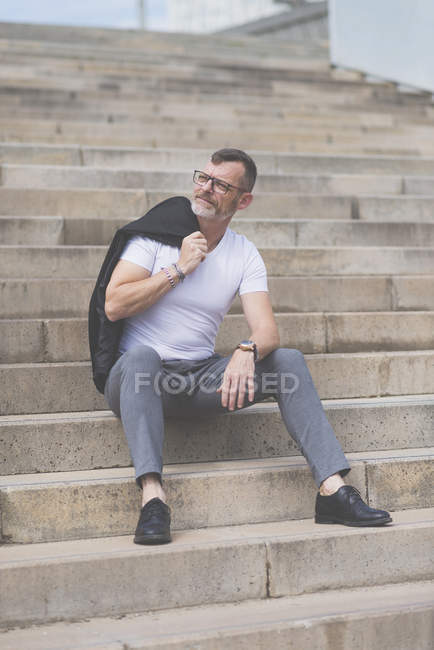 Businessman sitting on stairs — Stock Photo