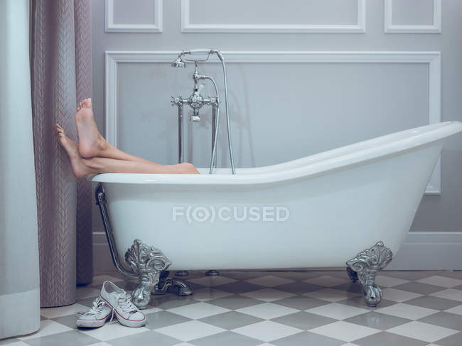 Legs of woman resting in bath — Stock Photo