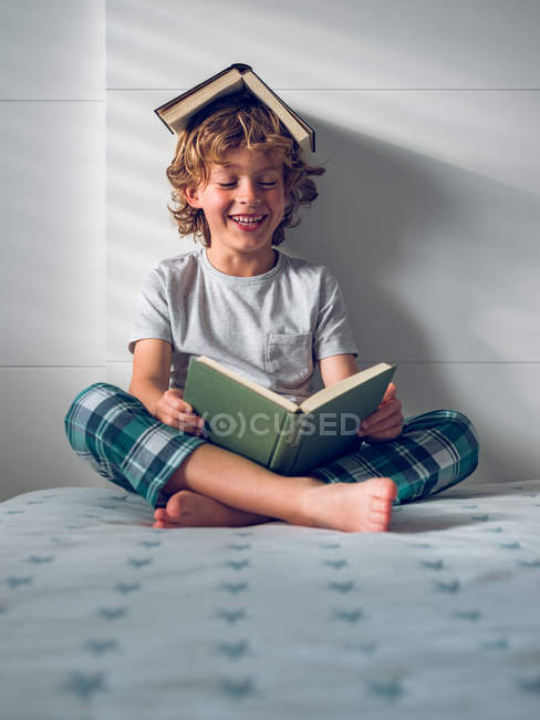 Funny boy reading book — Stock Photo