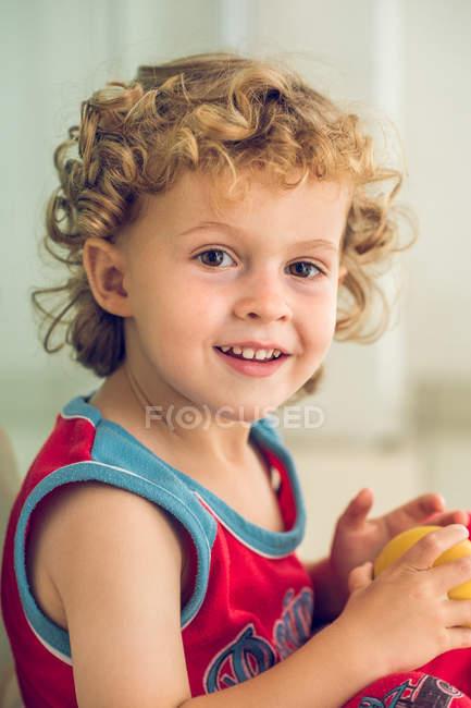 Little boy holding ball — Stock Photo