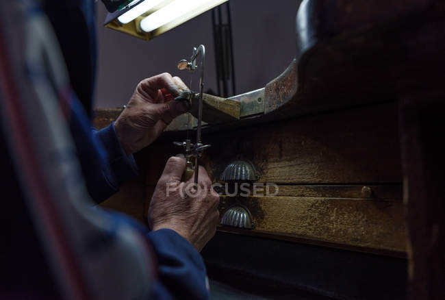Unrecognizable man working with tool in jewelry factory — Stock Photo