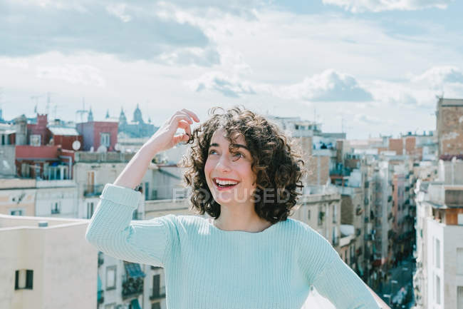 Woman standing with view of town — Stock Photo