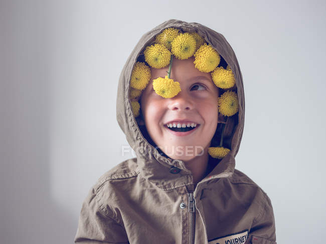 Boy with flowers in hood — Stock Photo