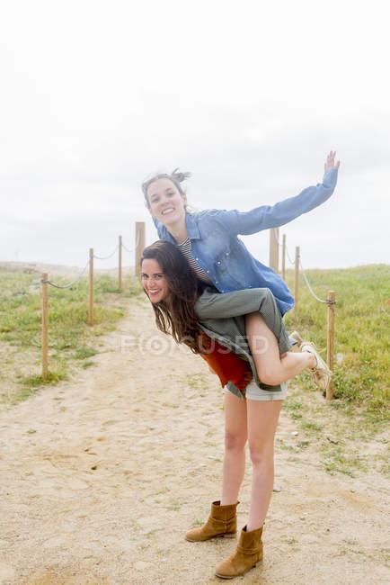 Riding piggyback - Stock Photos, Royalty Free Images | Focused