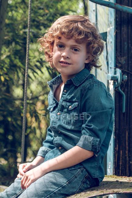 Boy sitting outside of wagon — Stock Photo
