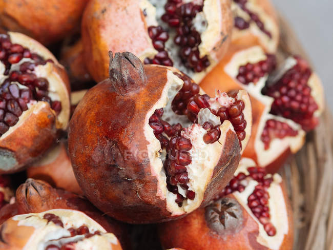 Heap of partly peeled organic pomegranates — Stock Photo