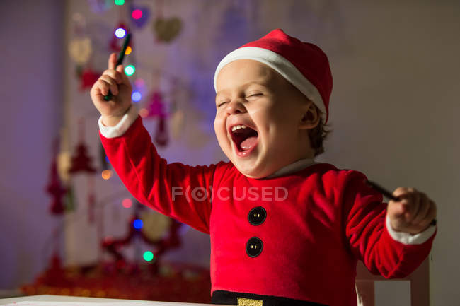 Happy little boy in Christmas clothes — Stock Photo