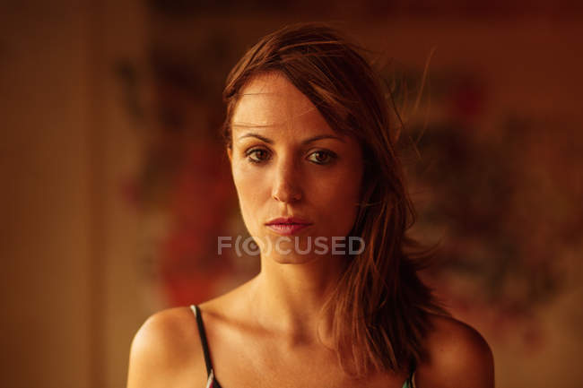 Tender young woman in soft light looking at camera — Stock Photo