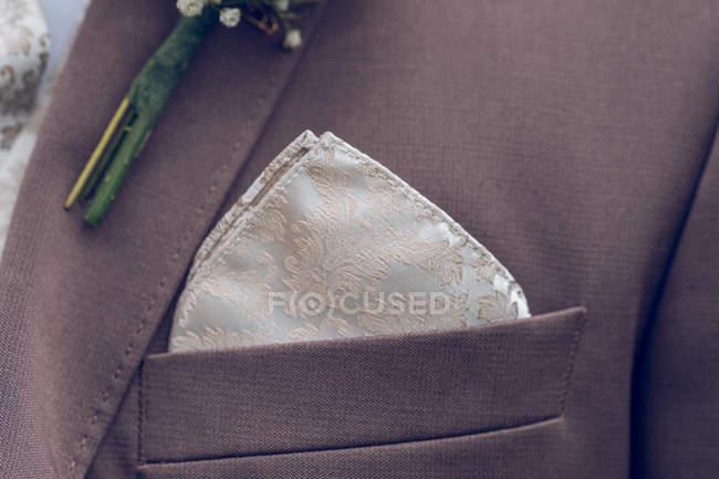 Close-up of Elegant pastel groom handkerchief on groom jacket — Stock Photo