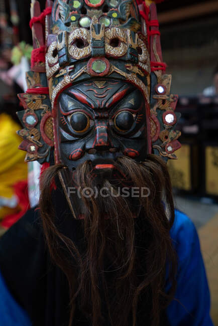 Miao person wearing traditional mask — Stock Photo