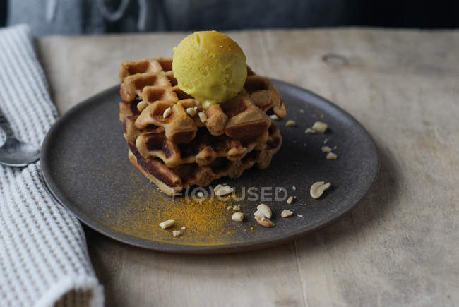Waffles with banana and curry ice cream on plate — Stock Photo