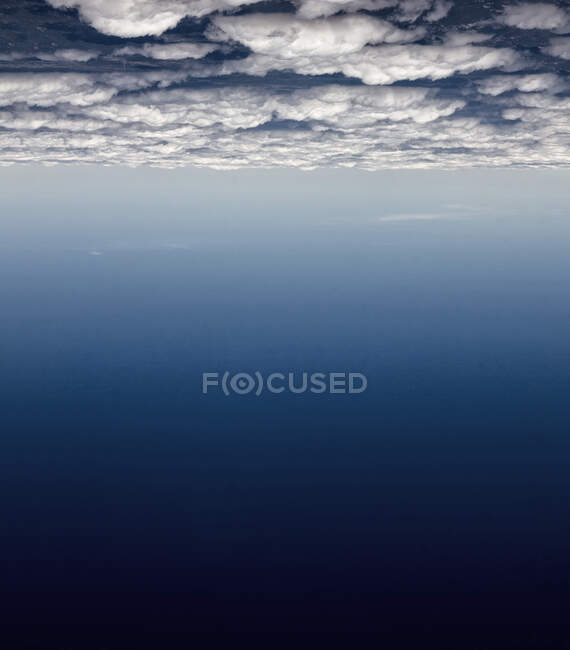 Upside down shot of white clouds and gradient cosmic blue sky — Stock Photo