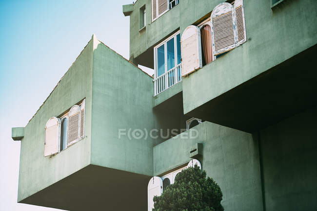 Vintage architecture of a colorful building windows — Stock Photo
