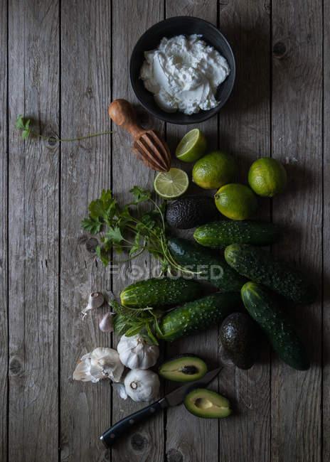 Ingredients for preparing tzatziki on wooden table — Stock Photo