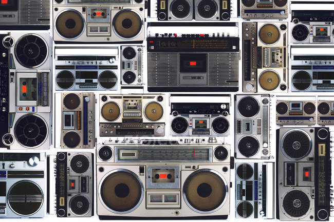 Arrangement of retro boomboxes on white background — Stock Photo