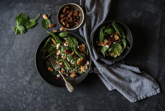 Salad with vegetables and cheese on grey surface — Stock Photo