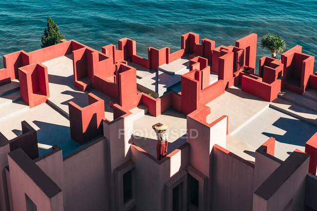 Black woman standing in a colorful geometric building roof terrace — Stock Photo