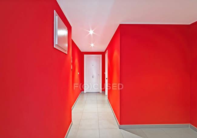 White doors in modern red corridor — Stock Photo