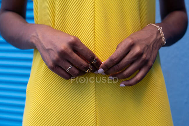 Crop woman hands with rings on a blue background — Stock Photo