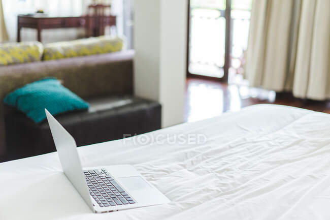 Laptop on the bed — Stock Photo
