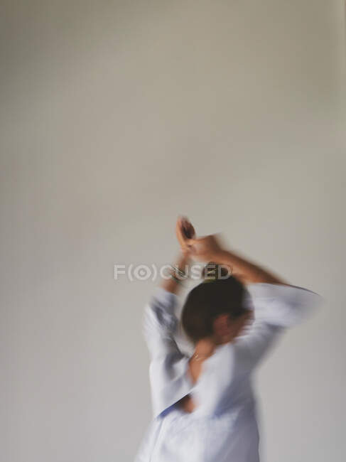 Blurred woman jumping on bed — Stock Photo